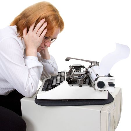 affliction: The woman near a typewriter on a white background Stock Photo