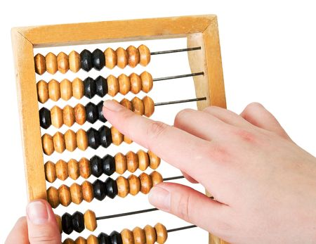 Wooden abacus in hands on a white background photo