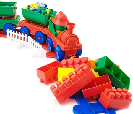 blockage: Toy steam-engin got to a blockage from multi-colour bricks on the white background
