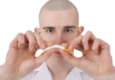 The man breaks cigarette on a white background Stock Photo - 3790257