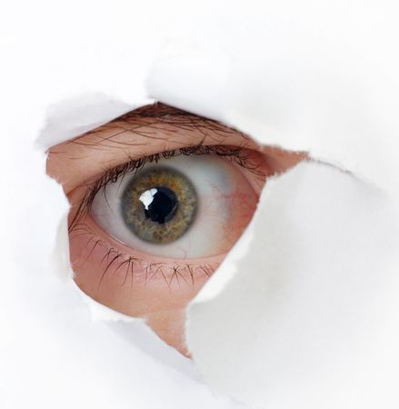 The eye looking through a hole in a paper Stock Photo - 3794517