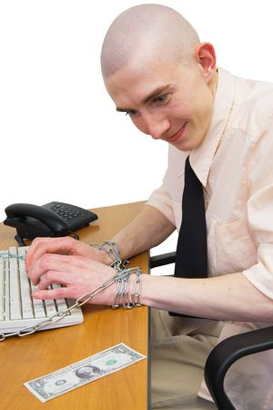 Man riveted by chain to keyboard with longing looks at dollar photo