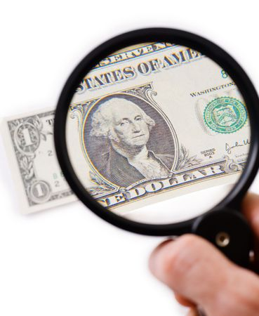 counterfeit: Counterfeit dollar on magnifier photographed on a white background Stock Photo
