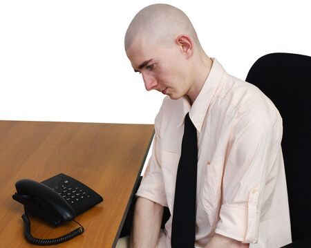 expectation: Man sits on easy chair in expectation of telephone call