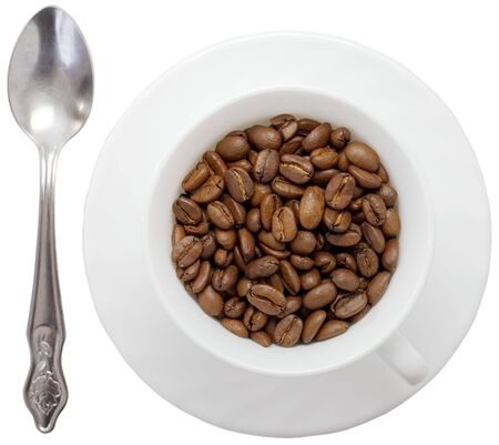 Cup costing on saucer pervaded grain coffee Stock Photo
