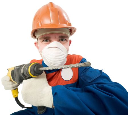 perforator: Builder in respirator and with perforator in hands