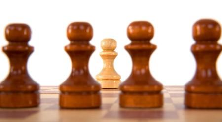 biege: Wooden dark brown pawns and one biege pawn