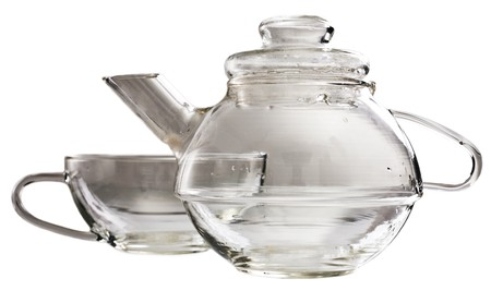 stand teapot: A transparent glass tea-set standing on a table Stock Photo