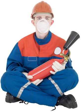 Man in overalls and fire-extinguisher on white background photo