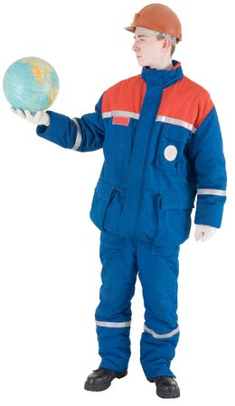 globe  the terrestrial ball: Man in overalls keep on the hand terrestrial globe