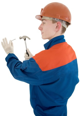 Man in worker cloth with hammer and nail photo