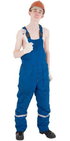 denuded: Man in worker overalls with denuded by torso