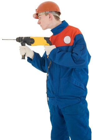perforator: Man in dark blue overalls holding on hands perforator