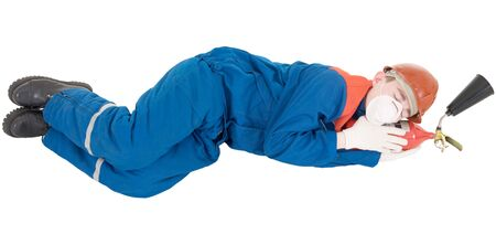 Man in overalls sleeping on the fire-extinguisher Stock Photo - 3990609