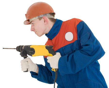 Man in worker cloth holding yellow perforator on the hands photo