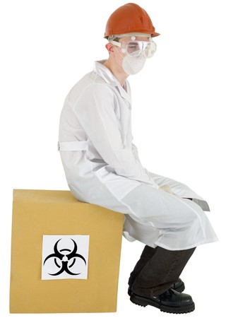 Man in garb scientist sits on box with inscription biohazard Stock Photo - 4054189