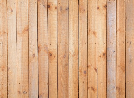 Surface of wall covered a rough wooden plank photo