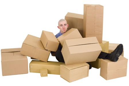 heap up: The young man is heap up by carton boxes