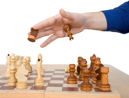 chessman: Male hand hold chess-man on the white background Stock Photo
