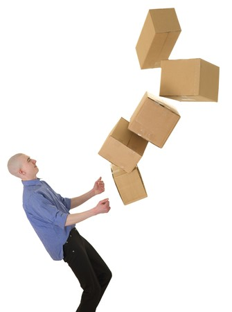 to stumble: Man drops boxes on a white background