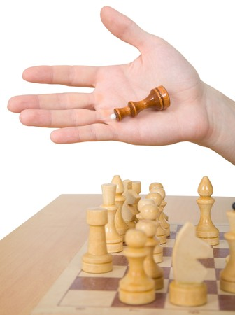 chessman: Hand and chess-man on a white background Stock Photo