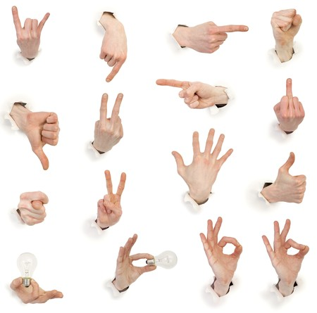 Sixteen gestures male hands through white paper photo