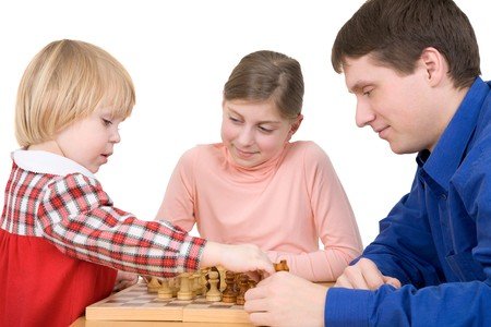 trained: Man and children play chess on white  Stock Photo