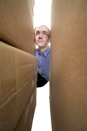 stockman: Male face between cardboard boxes on white