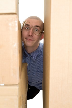 stockman: Male face clamping between cardboard boxes on white Stock Photo