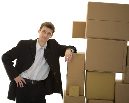stockman: Man lean ones elbows on pile cardboard boxes