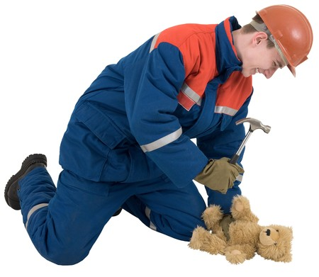 Man with hammer and toy brown bear photo