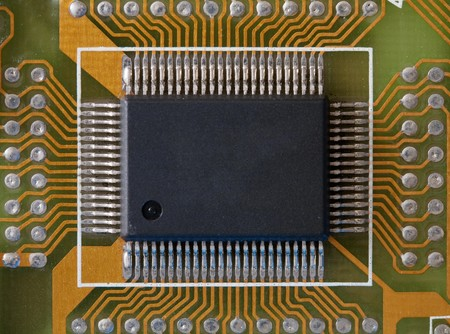 Microphoto of an integrated microcircuit of black colour