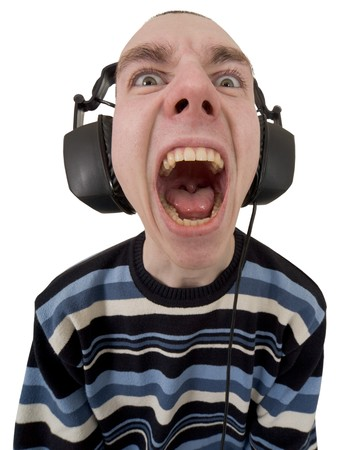 The person in ear-phones shouting at a white background photo