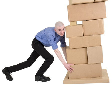 stockman: Man push pile from cardboard boxes on white