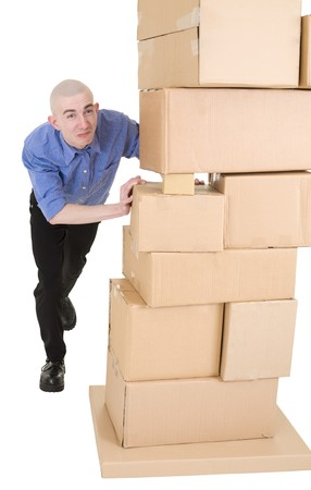 stockman: Man pushing heap from cardboard boxes on white Stock Photo