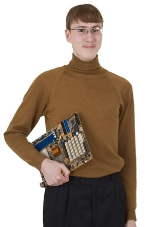 Young man in spectacles holding motherboard on hand photo