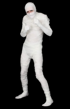 egyptian mummy: The Egyptian mummy standing on a black background