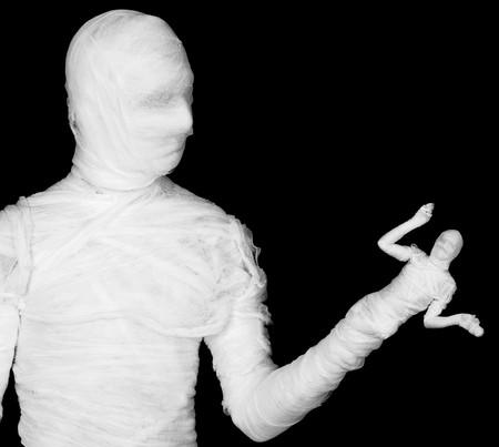 phantasmagoric: The phantasmagoric mummy - puppeteer on a black background