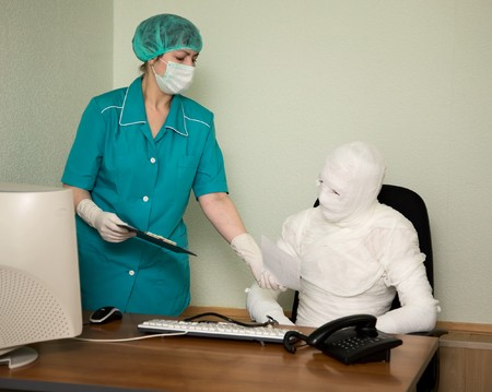 The patient similar to a mummy and the doctor, at office photo
