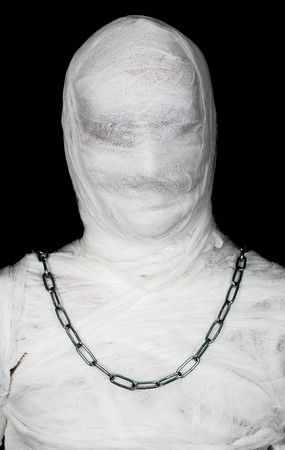 mummified: Egypt mummy portrait with chain of neck on black