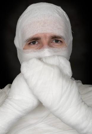 mummified: See no evil, say no evil, hear no evil on black Stock Photo