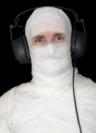Man in bandage with ear-phones on black Stock Photo - 4336620