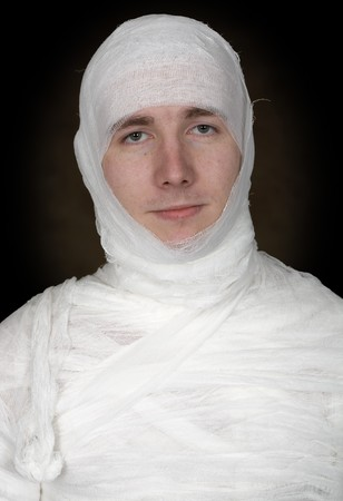 pity: Portrait of totally bandaged sickly sad man