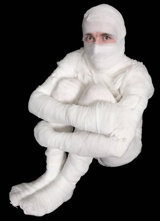 Egyptian mummy emo sitting on the black background Stock Photo - 4336545