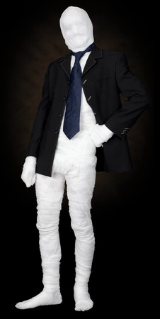 invisible: Mummy in jacket and tie on the black background