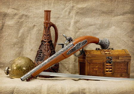 stilllife: Still-life with a pistol, bottle, rapier and trunk