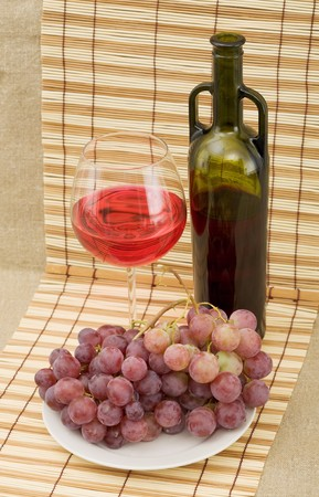 Still life with grapes and wine on mat Stock Photo - 4405594