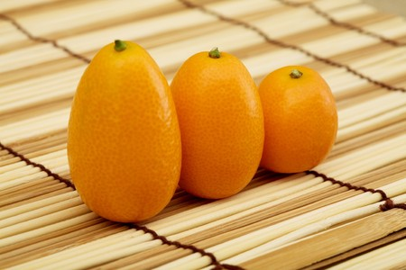 stilllife: Still-life - the fresh kumquat against a mat
