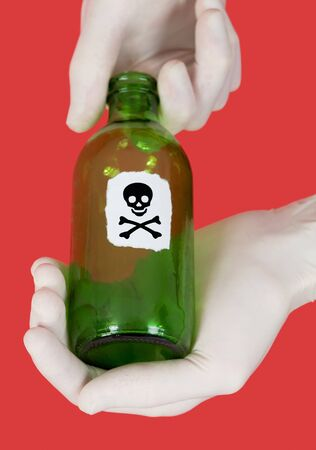 Green bottle with skull and crossbones on hand photo