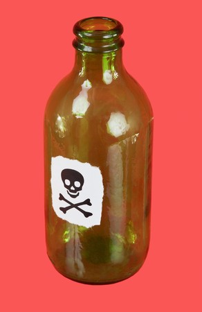Green bottle with sticker skull and crossbones on red photo
